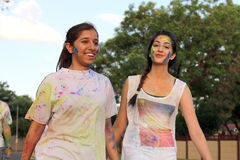 Two Chearful running young Indian girls covered with powder pain Royalty Free Stock Photos