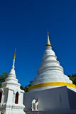 Two Chedi 's at Wat Phra Singh with blue sky Stock Photos