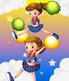 Two cheerdancers with their pompoms. Illustration of the two cheerdancers with their pompoms Stock Images