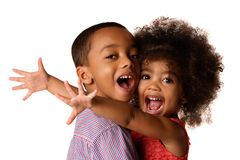 Two cheerful african-american siblings, sister hugging her brother, isolated. On white background royalty free stock image