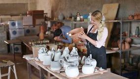 Two cheerful artisans having ceramics stock video footage