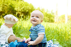 Two cheerful babies. In park Stock Images