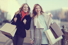 Two cheerful blonde for a walk Royalty Free Stock Photography