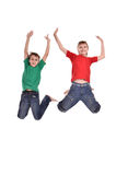 Two cheerful boys jumping Stock Photos