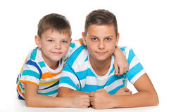 Two cheerful brothers on the floor Stock Photo