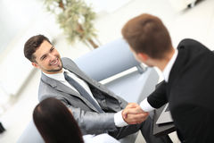 Two cheerful business men shaking hands Stock Image