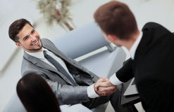 Two cheerful business men shaking hands Stock Photography