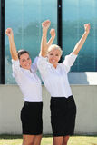 Two cheerful business women in the street Royalty Free Stock Photography