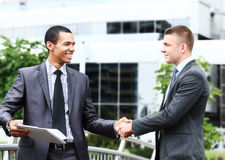 Two cheerful businessman handshaking Stock Photo
