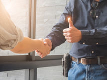 Two cheerful businessman handshaking in office.  Royalty Free Stock Images