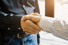 Two cheerful businessman handshaking in office. royalty free stock photos