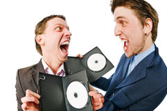 Two cheerful businessmen with blank DVDs Royalty Free Stock Photography