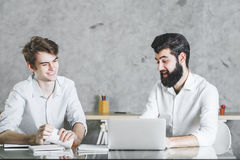Two cheerful businessmen working on project together Royalty Free Stock Photography