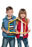 Children are holding model of a house Royalty Free Stock Photo
