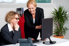 Two cheerful corporate women in office Royalty Free Stock Image