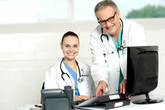 Two cheerful doctors at hospital Stock Photos