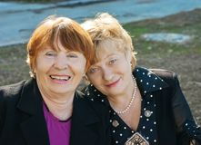Two cheerful elderly women. Outdoors stock images