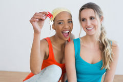 Two cheerful female friends with house keys Stock Photography