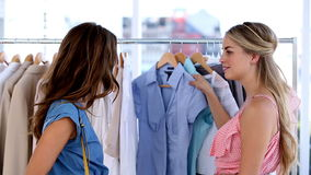 Two cheerful friends doing shopping together stock footage