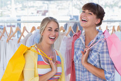 Two cheerful friends holding shopping bags Royalty Free Stock Photo