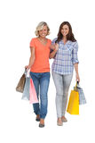 Two cheerful friends with shopping bags Stock Images