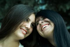 Two cheerful girls. Two cheerful girls are pleased to good day Royalty Free Stock Photography
