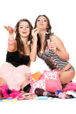 Two cheerful girls blow bubbles. Isolated Stock Photo