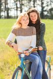 Two cheerful girls during cycling Stock Photo