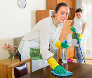 Two cheerful girls make cleaning Royalty Free Stock Images