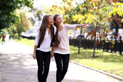 Two cheerful girls twins. In the street Royalty Free Stock Images