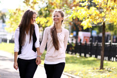 Two cheerful girls twins. In the street Royalty Free Stock Photography