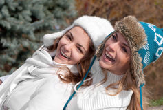 Two cheerful girls twins, in the park. Happy two cheerful girls twins, in the park Royalty Free Stock Photos
