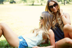 Two cheerful girls twins. In the park Stock Photography
