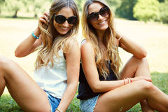 Two cheerful girls twins. In the park Royalty Free Stock Photos