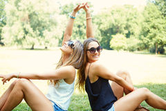 Two cheerful girls twins. In the park Stock Photos