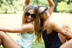 Two cheerful girls twins. In the park Stock Photo
