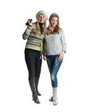 Two cheerful girls twins. In the street, two friends in the studio Stock Photos