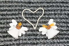Two cheerful paper angel and heart Royalty Free Stock Photography