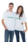 Two cheerful people wearing volunteer tshirt Stock Images