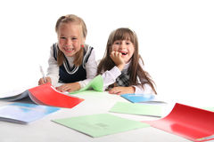 Two cheerful schoolgirls Royalty Free Stock Photography