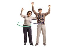 Two cheerful seniors with hula-hoops. Full length portrait of two cheerful seniors with hula-hoops isolated on white background Stock Image