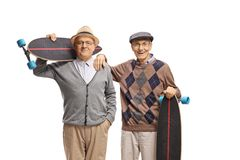 Two cheerful seniors with longboards. Isolated on white background royalty free stock photo