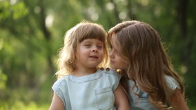 Two cheerful sisters hug. Family time. Two cheerful sisters. Cute girl hugging and kissing. Family values stock video