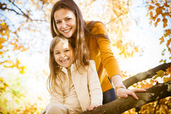 Two cheerful sisters playing in the park Royalty Free Stock Image