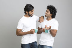 Two cheerful smart young male chatting with cup of coffee Stock Photo