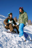 Two cheerful snowboarders Stock Image