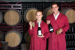 Two cheerful winery employees in aging section in cellar Royalty Free Stock Photo