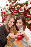 Two cheerful women with Christmas chains and balls Royalty Free Stock Image