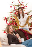 Two cheerful women with Christmas chains and balls Royalty Free Stock Photos