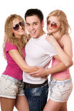 Two cheerful women and handsome young man Stock Photography